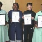 """Kathy Mthembu, Gloria Sewale, Kerry Solomon and Rachel Zuma receiving their certificates"""